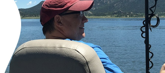 John Monteith looks out over the water while fishing