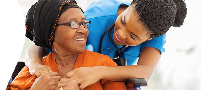 Photo of a patient and her caregiver