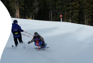 With assistance from facilitator at Breckenridge Outdoor Education Center, Ty experiences skiing for the first time since his accident in 2011.