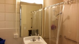The newly remodeled bathroom with accessible shower stall.