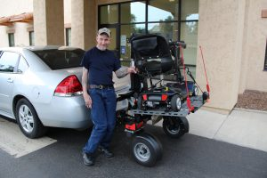 Jamie Write with his new powerchair trailer