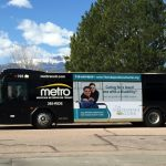 Colorado Springs Metro Bus with ad from The IC on the side