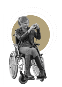 Photo of a woman using a wheelchair taking photos