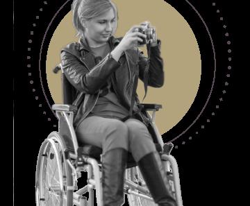 Photo of a woman using a wheelchair taking photos