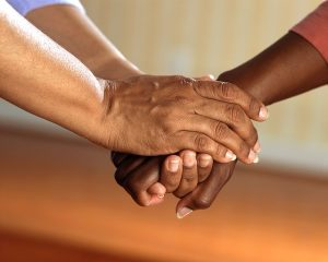 What to Expect from Home Health Care: image showing two sets of feminine hands grasping each other as if for comfort