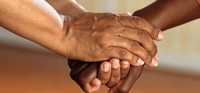 What to Expect from Home Health Care: image shows two sets of feminine hands grasping each other as if for comfort