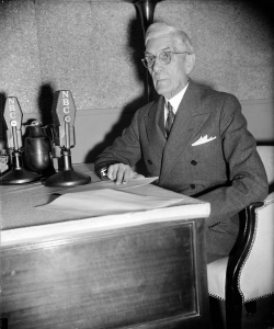 Black and white photo of Dr. Townsend at a desk with an NBC microphone