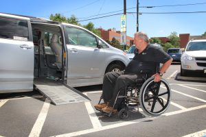 Photo of Tim Ashley loading into his accessible van.
