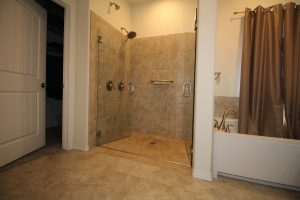Photo of Jeremy's universally designed shower with reinforced pull bars and zero entry shower.
