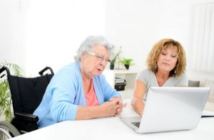 Elderly woman learning about SSI/SSDI benefit