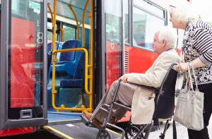 Older couple boarding a bus