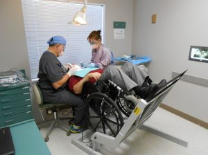 Dental Patient getting exam in wheelchair lift