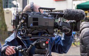 News photographer with camera
