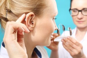 Woman being fitted with a hearing aid