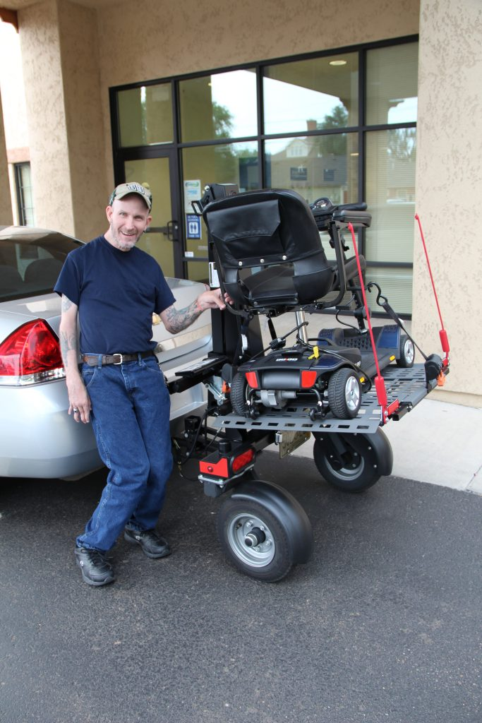 Jamie Wright with his new powerchair trailer