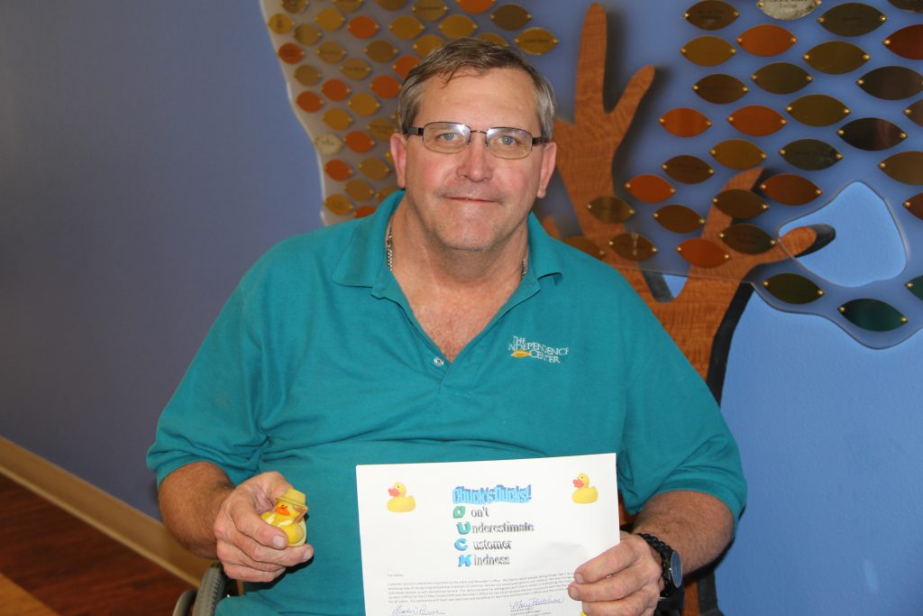 Tim Ashely Proudly Displaying His Chuck's Ducks Award