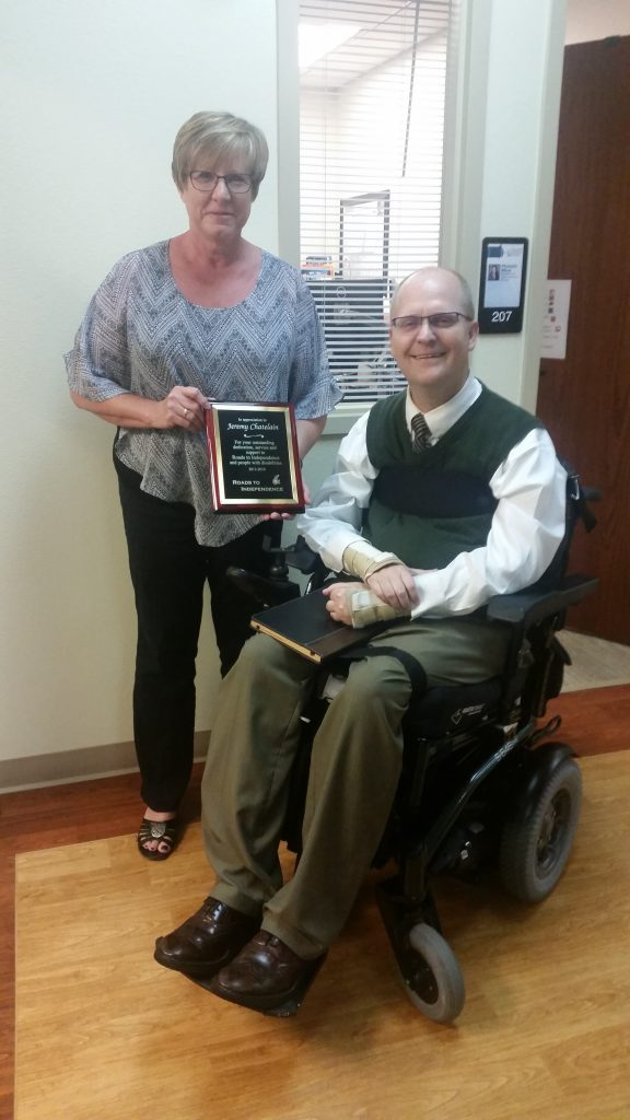 Jeremy, with The IC's Dixie Herring Displaying Award