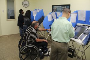 People with Disabilities Voting at The IC
