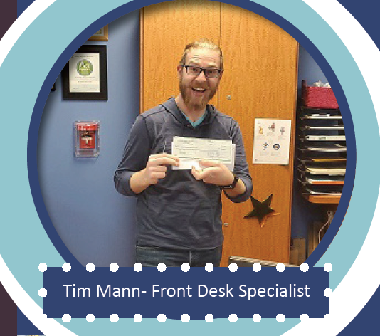 Tim Mann, front desk specialist, posing for the camera