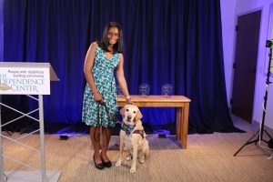 Serina Gilbert poses with her assistance dog