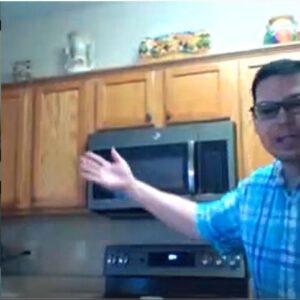 Man gesturing in kitchen