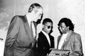 A photo of Sylvia Walker with Jay Rochlin and Thomas McKeithan, 1990
