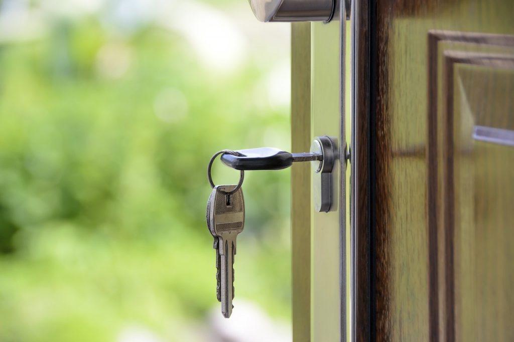 Photo of keys in the lock of a door